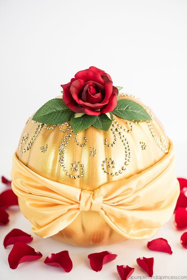 """<p>No beasts here: Gild your pumpkin in gold paint, and then accessorize it with jewels, satin ribbon, and rose petals for a look that Belle would approve of. </p><p><a class=""""link rapid-noclick-resp"""" href=""""https://www.amazon.com/Louis-Garden-Artificial-Silk-Flowers/dp/B00YY0B2DG/?tag=syn-yahoo-20&ascsubtag=%5Bartid%7C10055.g.2592%5Bsrc%7Cyahoo-us"""" rel=""""nofollow noopener"""" target=""""_blank"""" data-ylk=""""slk:SHOP SILK ROSE"""">SHOP SILK ROSE</a></p><p><em><a href=""""https://apumpkinandaprincess.com/diy-disney-belle-pumpkin/"""" rel=""""nofollow noopener"""" target=""""_blank"""" data-ylk=""""slk:Get the tutorial at A Pumpkin & A Princess »"""" class=""""link rapid-noclick-resp"""">Get the tutorial at A Pumpkin & A Princess »</a></em></p>"""