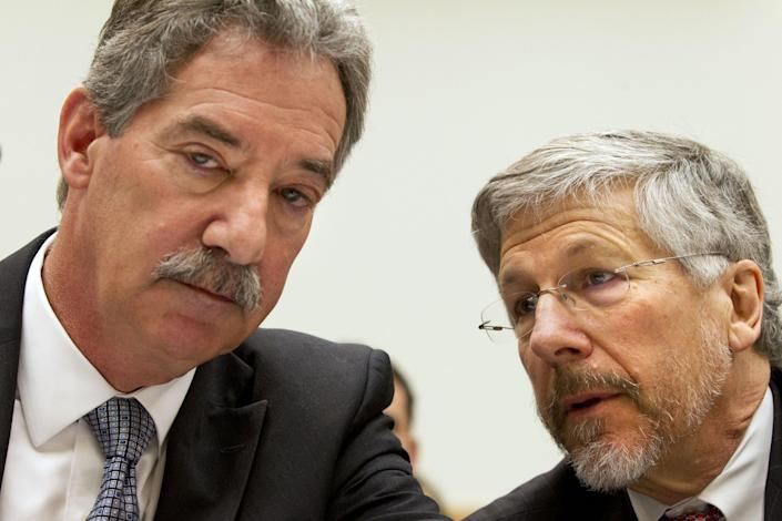 Deputy Attorney General James Cole, left, speaks with Robert S. Litt, general counsel in the Office of Director of National Intelligence before the start of a House Judiciary Committee hearing on Capitol Hill in Washington, on Wednesday, July 17, 2013. Six weeks after a leaked document exposed the scope of the government's monitoring of Americans' phone records, the House Judiciary Committee calls on key administration figures from the intelligence world to answer questions about the sweeping government surveillance of Americans in war on terrorism. (AP Photo/Jacquelyn Martin)