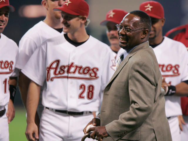 FILE - In this June 25, 2005, file photo, former Houston Astro Jimmy Wynn is joined by current players as he prepares to throw out the ceremonial first pitch after his jersey number was retired in Houston. Wynn, the slugger who earned his nickname of The Toy Cannon during his days with the Astros in the 1960s and '70s, has died. Wynn was 78. The Astros said he died Thursday, March 26, 2020, in Houston, but did not provide further details. (AP Photo/Pat Sullivan, File)