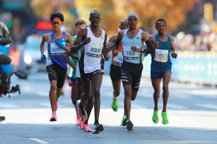 Albert Korir of Kenya, leads the pack at mile 16 on First Avenue during the 2019 TCS New York City Marathon, Nov. 3, 2019 in New York City. (Photo: Gordon Donovan/Yahoo News)