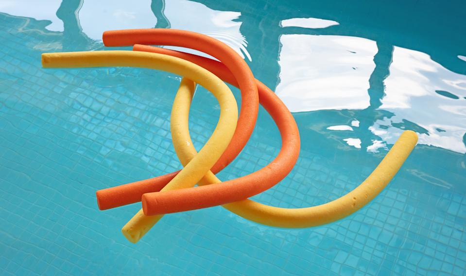 Aqua noodles floating in a indoor swimming pool, selective focus
