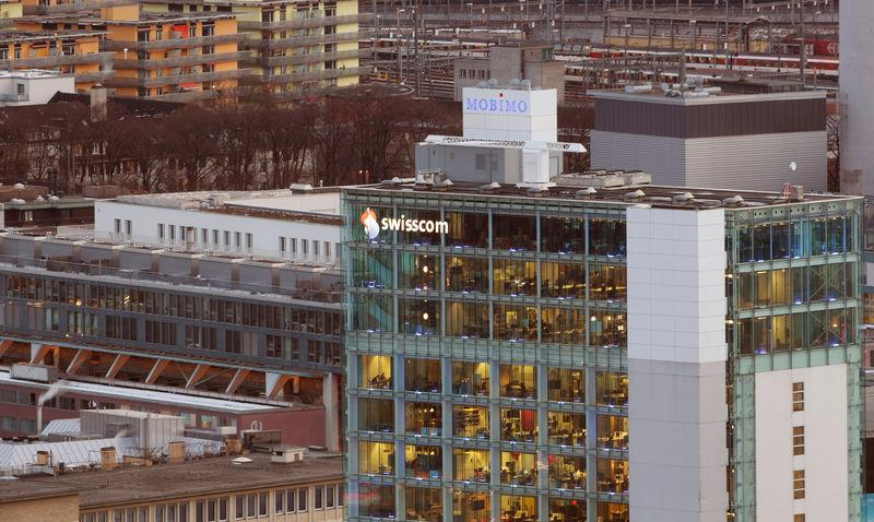 Logo of Swiss telecommunications company Swisscom is seen at an office building in Zurich