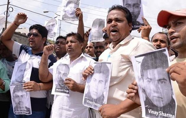 Indian activists of the Bhartiya Janta Party Scheduled Caste Morcha, shout slogans as they hold posters of four accused in a gang rape case of a student in New Delhi during a demonstration in Amritsar on September 11, 2013
