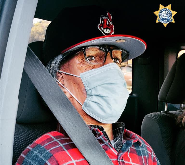A dummy wearing a Cleveland Indians cap is seen seated in a car.