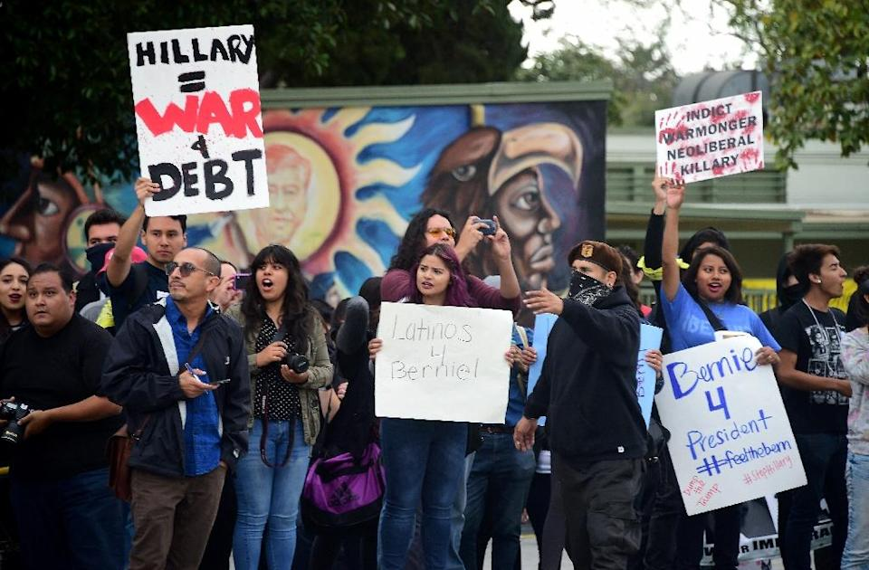 People protest US Democratic presidential candidate Hillary Clinton on May 5, 2016 in Monterey Park, California (AFP Photo/Frederic J. Brown)