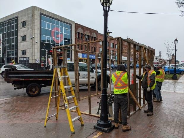 Around noon on Friday city staff began covering up the statue.