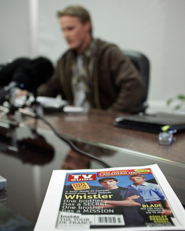"A copy of a cover of TV Guide promoting the CTV program ""Whistler"" sits on a boardroom table as Ross Rebagliati reads his statement of claim against the television network and the producers of the show during a press conference in Vancouver on August 2, 2006. Rebagliati is upset that the show misappropriates and defames his character. (CP PHOTO/Richard Lam)"