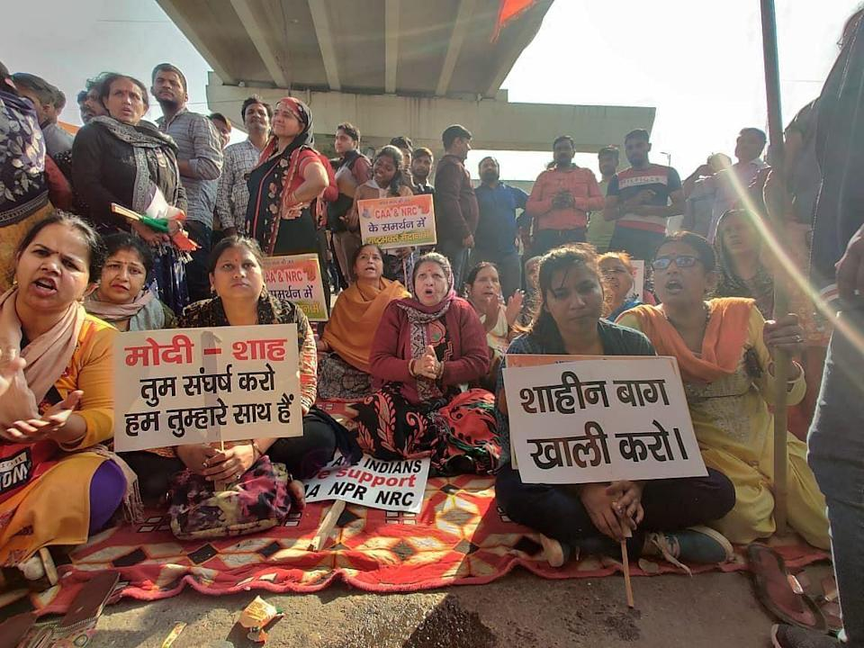 """<div class=""""paragraphs""""><p>Pro CAA protesters at Maujpur on 24 February, the first day of the 2020 vioence.</p></div>"""