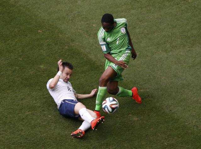 France's Mathieu Valbuena (L) fights for the ball with Nigeria's Ahmed Musa during their 2014 World Cup round of 16 game at the Brasilia national stadium in Brasilia June 30, 2014. REUTERS/David Gray (BRAZIL - Tags: SOCCER SPORT WORLD CUP)