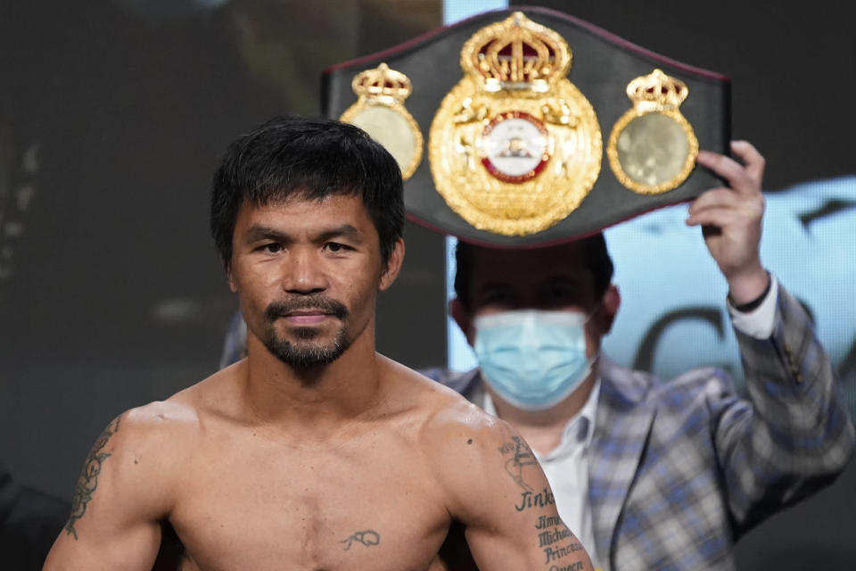 FILE - In this Aug. 20, 2021, file photo, Manny Pacquiao, of the Philippines, poses for photographers during a weigh-in in Las Vegas. Philippine boxing icon and senator Pacquiao says he will run for president in the 2022 elections. He accepted the nomination of his PDP-Laban party at its national convention on Sunday, Sept. 19, pledging to honestly serve the Filipino people who he said have been waiting for change in government. (AP Photo/John Locher, File)