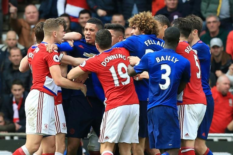 Middlesbrough and Manchester United players clash towards the end of their English Premier League match, at Riverside Stadium in Middlesbrough, on March 19, 2017