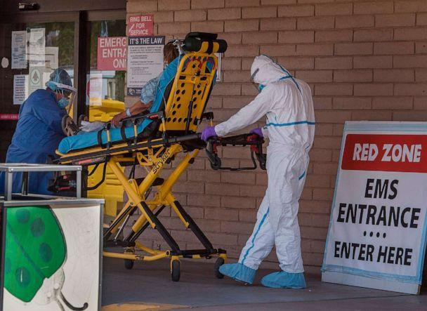 PHOTO: A patient is taken from an ambulance to the emergency room of a hospital in the Navajo Nation town of Tuba City in Arizona on May 24, 2020. (Mark Ralston/AFP via Getty Images)