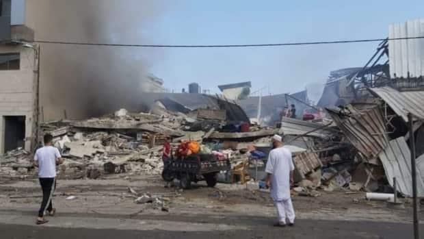 Hamdi Ashour says his relatives were given five minutes to evacuate their apartments and workshop before the building was destroyed during an attack that took place on Eid, a day of celebration for Muslims.
