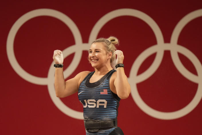 Katherine Elizabeth Nye of the United States celebrates after a lift in the women's 76kg weightlifting event, at the 2020 Summer Olympics, Sunday, Aug. 1, 2021, in Tokyo, Japan. (AP Photo/Luca Bruno)