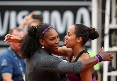 Tennis - Italy Open Women's Singles Final match - Serena Williams of the U.S. v Madison Keys of U.S. - Rome, Italy - 15/5/16 Williams embraces Keys after winning the match. REUTERS/Alessandro Bianchi