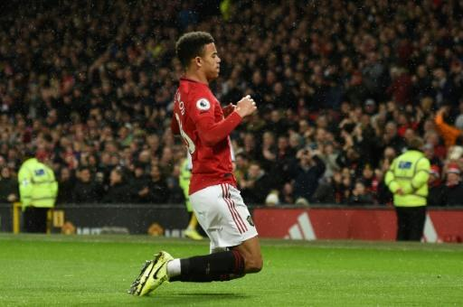 Manchester United striker Mason Greenwood celebrates after scoring his team's fourth goal in their 4-0 win against Norwich