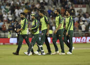 Pakistan players walk off the field after their loss in the third Twenty20 international cricket match against England at Old Trafford in Manchester, Tuesday, July 20, 2021. (AP Photo/Rui Vieira)