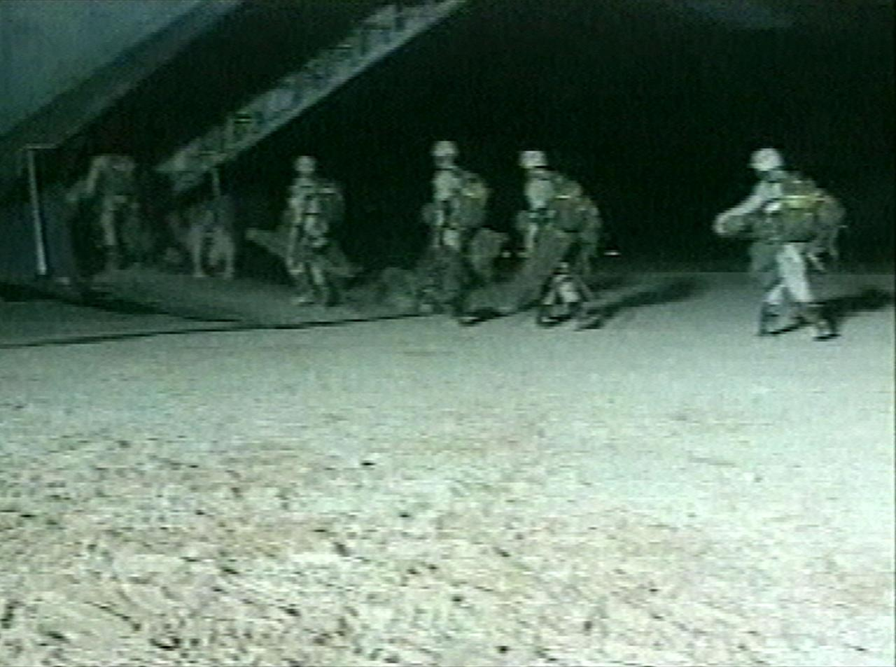 "FILE - This file image from video released by the U.S. Defense Department and made available Oct. 20, 2001, shows U.S. special forces boarding an unidentified aircraft at an unknown location, the day Joint Chiefs of Staff Chairman, Gen. Richard Myers, announced at the Pentagon that U.S. special forces ""attacked and destroyed targets"" in Afghanistan. The Central Intelligence Agency together with U.S. special operations were the first Americans into Afghanistan after the attacks of Sept. 11th, and will likely be the last U.S. forces to leave. (AP Photo/DOD Pool, File)"