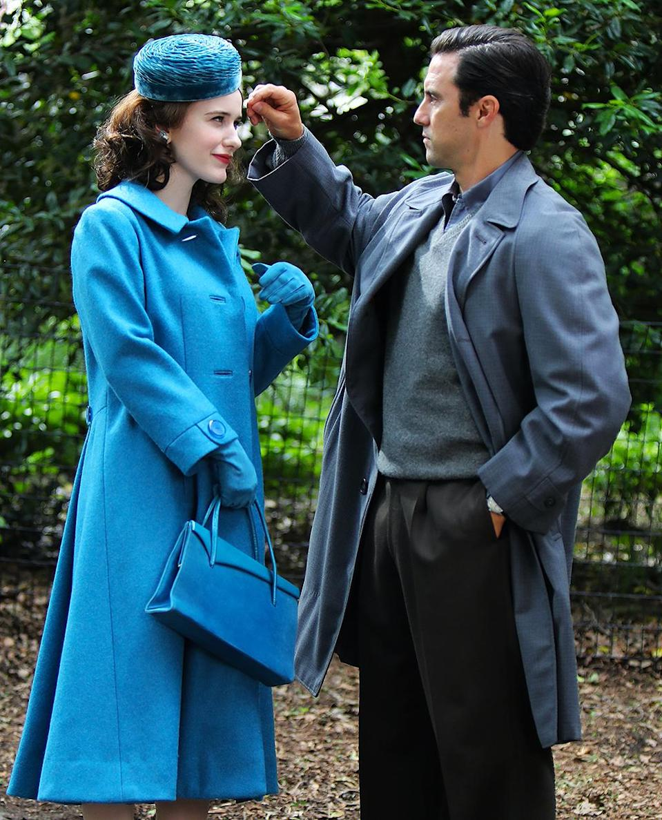 <p>In another, the <em>This Is Us </em>actor brushes a piece how hair away from Brosnahan's face. </p>
