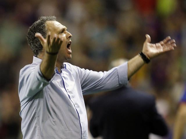 FILE - In this file photo dated Saturday, Oct. 5, 2013, Levante's coach Joaquin Caparros gesture during their La Liga soccer match against Real Madrid at the Ciutat de Valecia stadium in Valencia, Spain. Sevilla coach Joaquin Caparros announced Sunday April 7, 2019, that he has leukaemia but will stay on the job with the Spanish club. (AP Photo/Alberto Saiz, FILE)