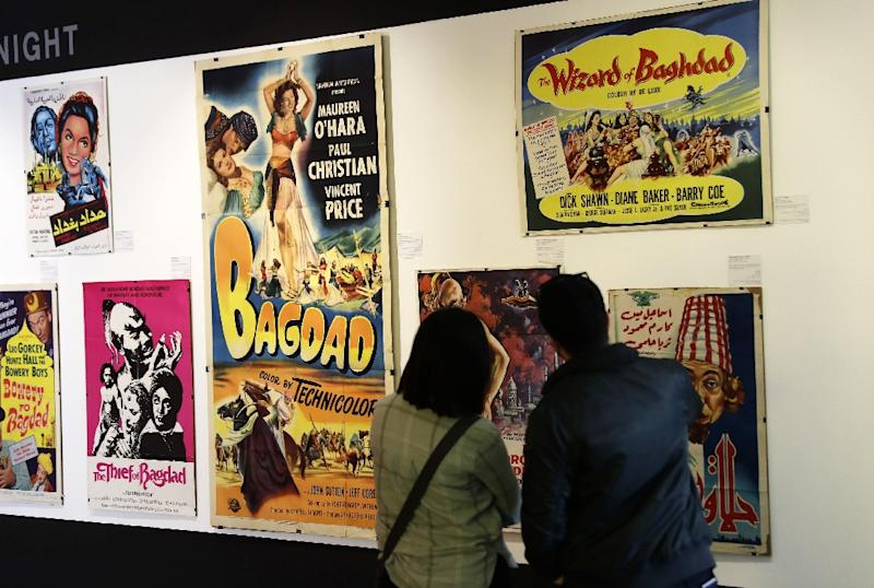 Lebanese film buff Abboudi Abu Jawdeh is exhibiting vintage film posters that show decades of Western cliches of the Arab world (AFP Photo/JOSEPH EID)