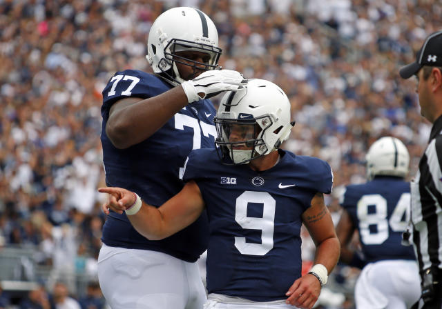 "STATE COLLEGE, PA – SEPTEMBER 01: <a class=""link rapid-noclick-resp"" href=""/ncaaf/players/243269/"" data-ylk=""slk:Trace McSorley"">Trace McSorley</a> #9 of the Penn State Nittany Lions celebrates after rushing for a 12 yard touchdown in the first quarter against the <a class=""link rapid-noclick-resp"" href=""/ncaaf/teams/aak"" data-ylk=""slk:Appalachian State Mountaineers"">Appalachian State Mountaineers</a> on September 1, 2018 at Beaver Stadium in State College, Pennsylvania. (Photo by Justin K. Aller/Getty Images)"