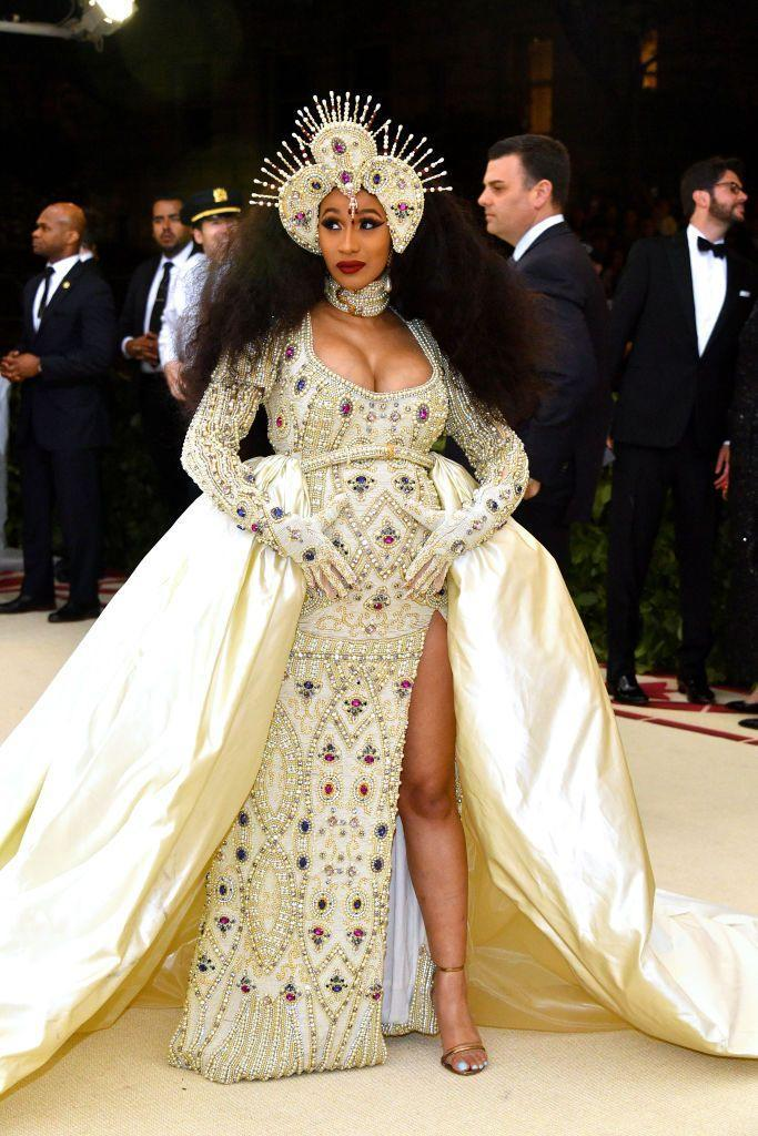 """<p>The mother-to-be wore a Moschino dress to the <a href=""""https://www.elle.com/uk/fashion/celebrity-style/g19888722/met-gala-2018-red-carpet-dresses-outfits/?slide=6"""" rel=""""nofollow noopener"""" target=""""_blank"""" data-ylk=""""slk:'Heavenly Bodies: Fashion & The Catholic Imagination'-themed gala"""" class=""""link rapid-noclick-resp"""">'Heavenly Bodies: Fashion & The Catholic Imagination'-themed gala</a>.</p>"""