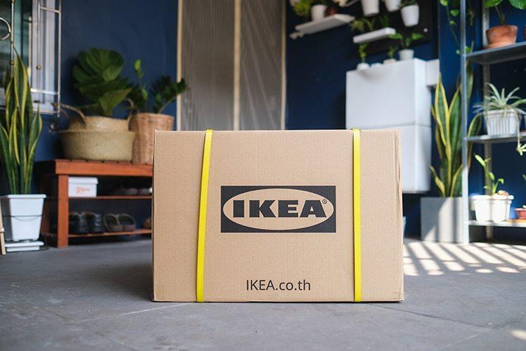 A sealed IKEA box sits waiting in a living area, ready to go back to the store as part of the company's new Buy Back program.