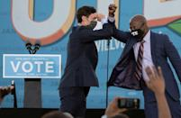 Democratic candidates for US Senate Jon Ossoff (L) and Raphael Warnock (R) are seeking to oust Republican incumbents in runoff elections that will determine the balance of power in Congress