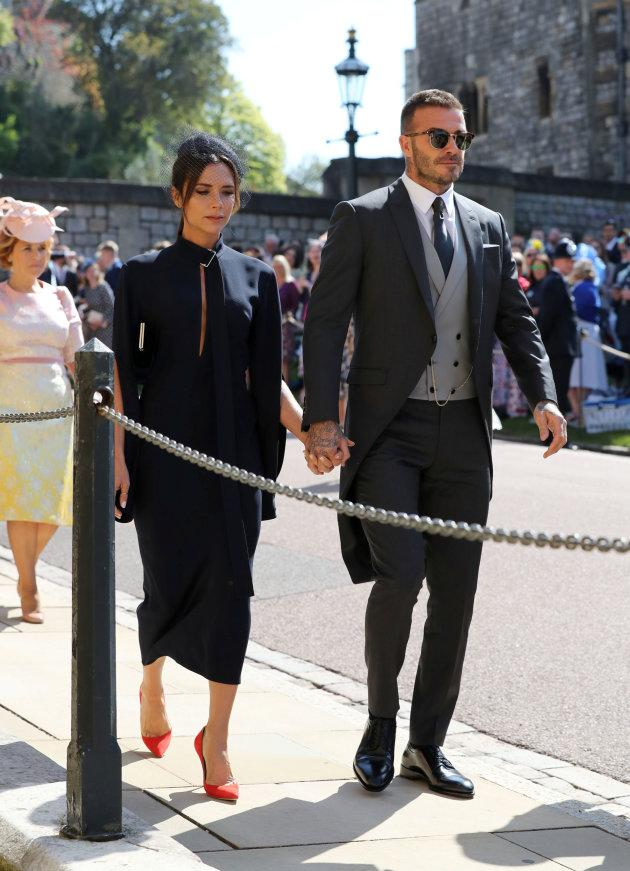 David Beckham and Victoria Beckham arrive at St George's Chapel at Windsor Castle for the wedding of Meghan Markle and Prince Harry in Windsor, Britain, May 19, 2018. Gareth Fuller/Pool via REUTERS