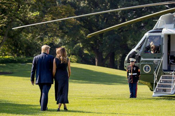 PHOTO: President Donald Trump and first lady Melania Trump walk across the South Lawn, Aug. 7, 2019, to board Marine One for a trip to Dayton, Ohio, and El Paso, Texas. (Andrew Harnik/AP)