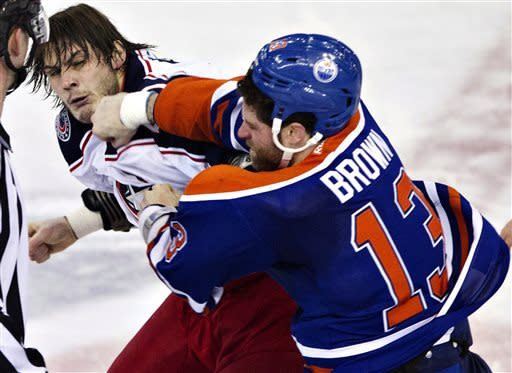 Columbus Blue Jackets' Jared Boll (40) and Edmonton Oilers' Mike Brown (13) fight during the second period of their NHL hockey game, Thursday, March 28, 2013, in Edmonton, Alberta. (AP Photo/The Canadian Press, Jason Franson)