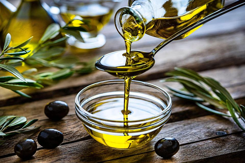 Olive Oil Pouring Into Dish