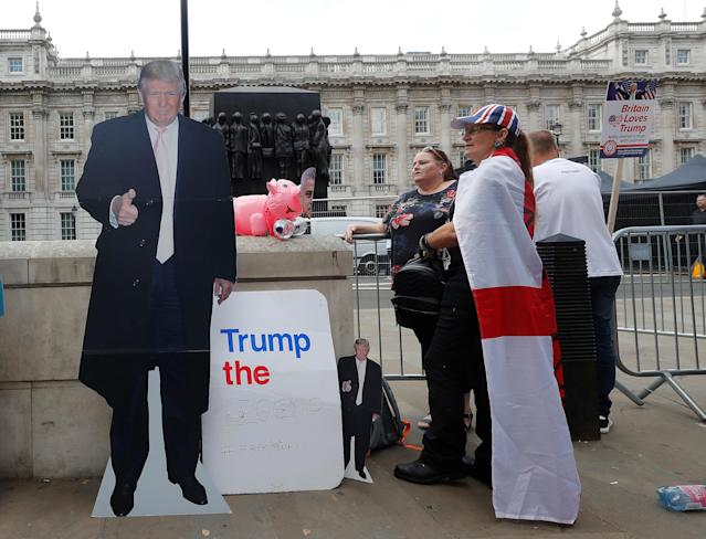"<p>Demonstrators stand next to a cardboard cut-out of President Trump and a sign reading ""Trump the Legend"" in London, July 14, 2018. (Photo: Yves Herman/Reuters) </p>"