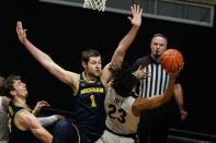Purdue guard Jaden Ivey (23) shoots over Michigan center Hunter Dickinson (1) during the first half of an NCAA college basketball game in West Lafayette, Ind., Friday, Jan. 22, 2021. (AP Photo/Michael Conroy)