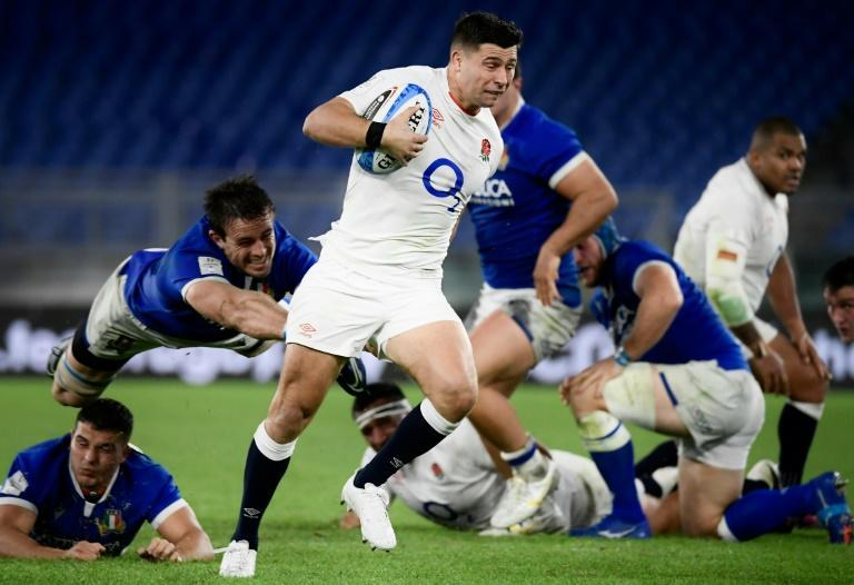 Scrum-half Ben Youngs (C) marked his 100th Test for England with two tries in a win over Italy as his side clinched the Six Nations title