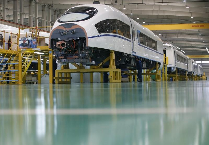 File photo of an employee working on a high speed train model CRH380B at a final assembly line of China CNR's Tangshan Railway Vehicle's factory in Tangshan, Hebei province