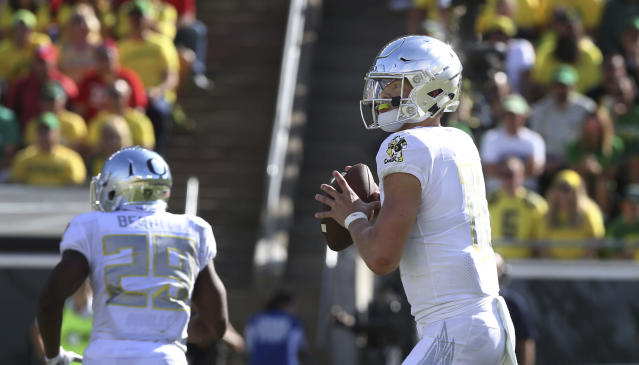 Oregon Justin Herbert drops back to pass against Nebraska during the third quarter of an NCAA college football game Saturday, Sept. 9, 2017, in Eugene, Ore. (AP Photo/Chris Pietsch)