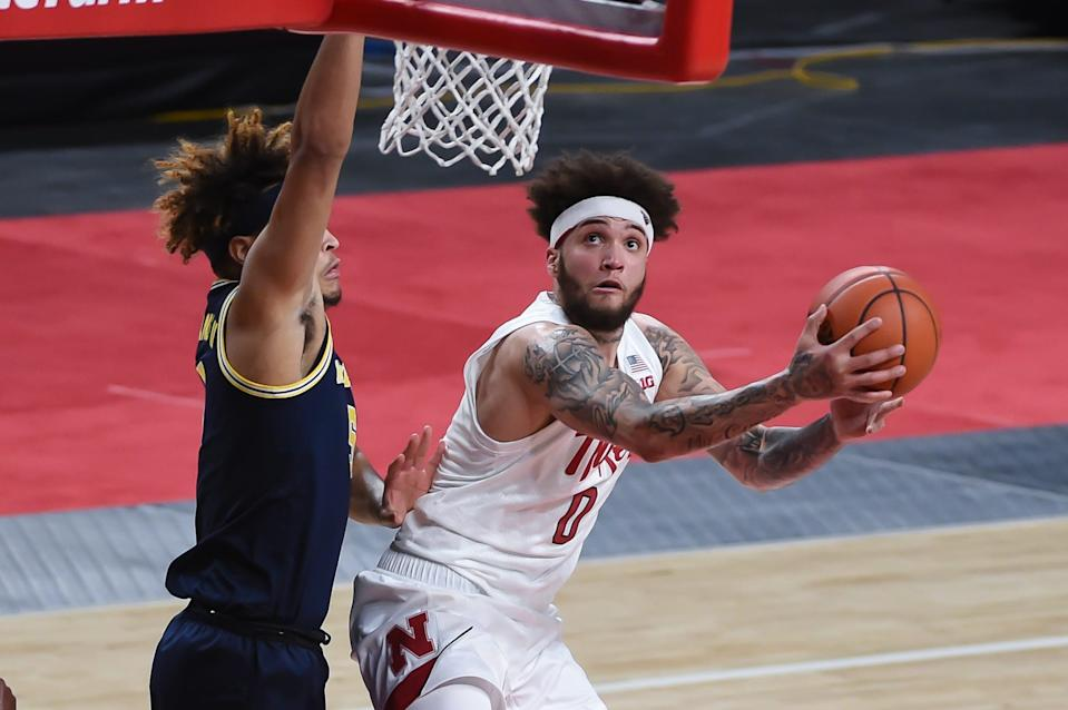 Cornhuskers guard Teddy Allen (0) drives to the basket against Michigan Wolverines forward Terrance Williams II (5) in the first half at Pinnacle Bank Arena on Friday, Dec. 25, 2020. Allen had 21 points in the first half.