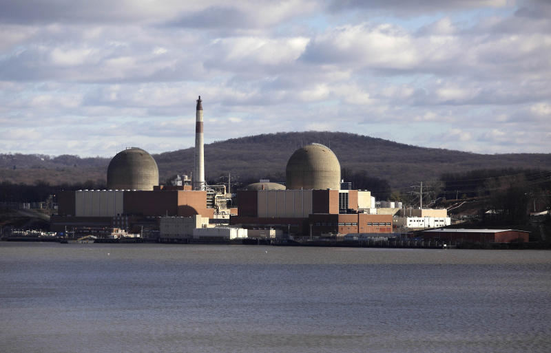 FILE - This Dec. 16, 2009, file photo, shows the Indian Point nuclear power plant in Buchanan, N.Y., as seen from across the Hudson River in Tomkins Cove, N.Y. U.S. nuclear plants will be allowed to keep workers on longer shifts to deal with staffing problems in the coronavirus pandemic. Nuclear Regulatory Commission officials outlined the temporary shift extensions to nuclear power officials on Thursday, April 2, 2020. (AP Photo/Julie Jacobson, File)