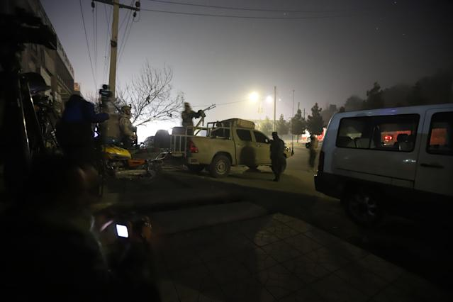 <p>Afghan security officials take up positions near the scene of attack by armed men at an upscale hotel in Kabul, Afghanistan on January 20, 2018. (Photo: Jawad Jalali/EPA-EFE/REX/Shutterstock) </p>