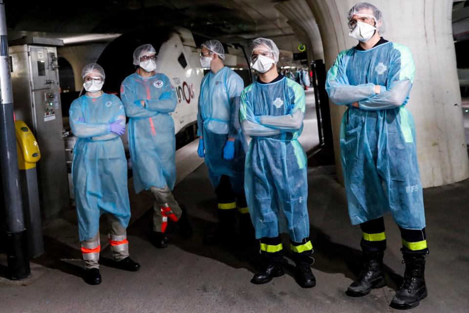 Medical staff wait on a platform of the Gare d'Austerlitz train station on April 1, 2020 in Paris before embarking 38 patients infected with the COVID-19 into two medicalised TGV high speed trains evacuated from Paris' region hospitals to other hospitals in the western France Brittany region where the outbreak has been limited so far. - France has been on lockdown since March 17 in a bid to limit the contagion caused by the novel coronavirus, a situation it has extended until at least April 15. (Photo by Thomas SAMSON / POOL / AFP) (Photo by THOMAS SAMSON/POOL/AFP via Getty Images)