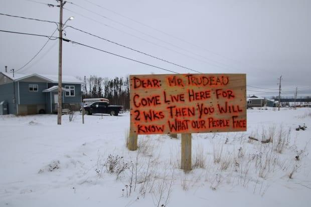 A sign in Neskantaga First Nation calls out Prime Minister Justin Trudeau for failing to end the community's 25-year-long boil water advisory.