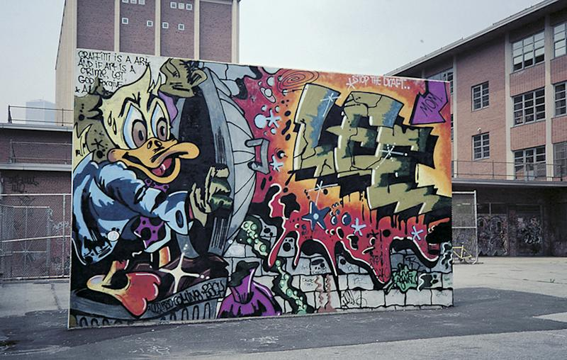"In this 1978 photo provided by the Museum of the City of New York, the graffiti mural ""Howard the Duck,"" is painted on a handball court in New York. The Lee Quinones mural was a pivotal work that helped propel the illicit graffiti art movement from the subway system to above ground, and into the mainstream. The original mural has been painted over, but Quinones recreated it on canvas and it is part of the exhibition, ""City as Canvas."" (AP Photo/Charlie Ahearn)"