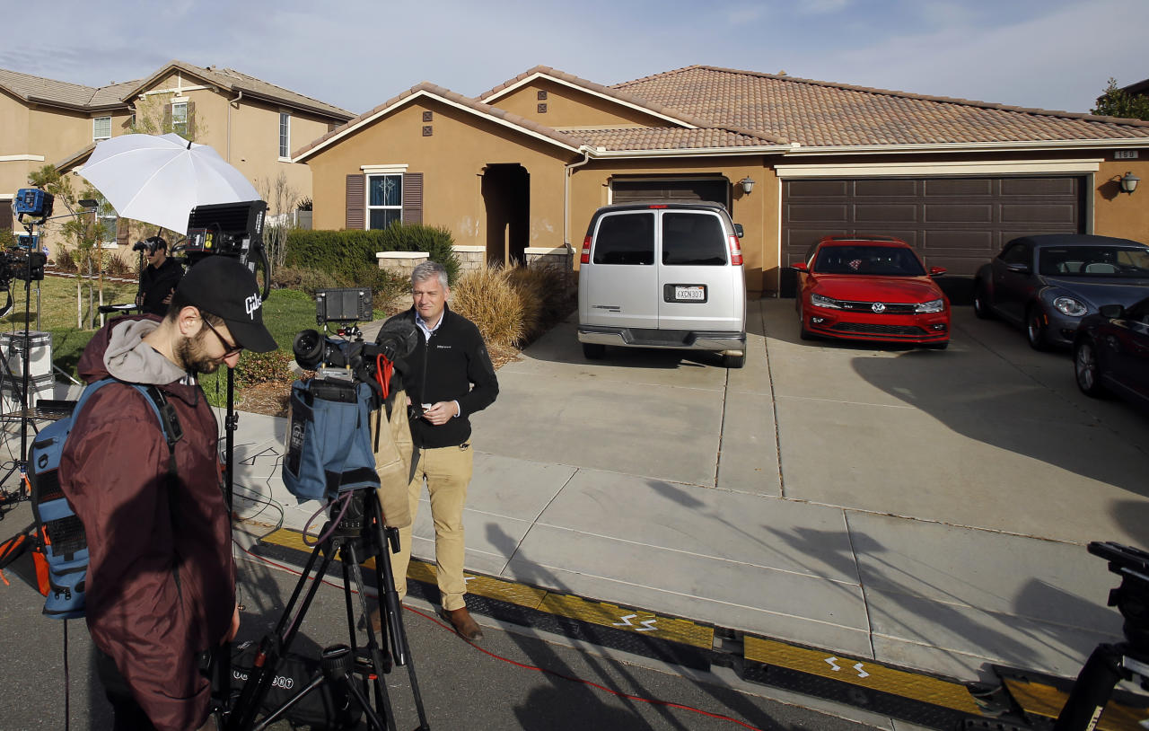 Members of the media work outside a home Tuesday, Jan. 16, 2018, where police arrested a couple on Sunday accused of holding their 13 children captive, in Perris, Calif. Authorities said an emaciated teenager led deputies to the California home where her 12 brothers and sisters were locked up in filthy conditions, with some of them malnourished and chained to beds. (AP Photo/Alex Gallardo)