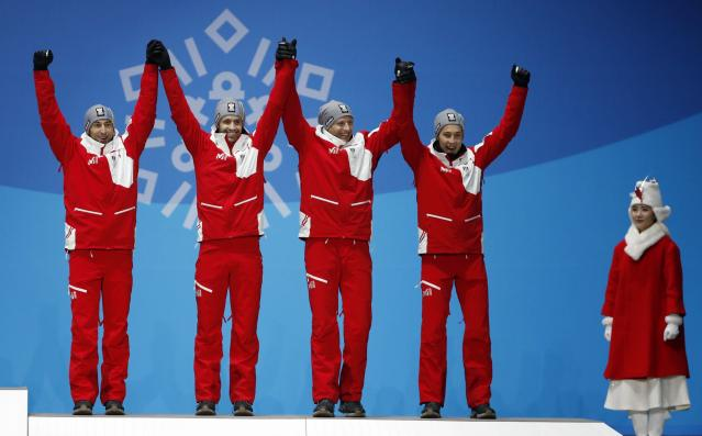 Medals Ceremony - Nordic Combined Events - Pyeongchang 2018 Winter Olympics - Men's Team 4 x 5 km - Medals Plaza - Pyeongchang, South Korea - February 23, 2018 - Bronze medalists Wilhelm Denifl, Lukas Klapfer, Bernhard Gruber and Mario Seidl of Austria on the podium. REUTERS/Kim Hong-Ji