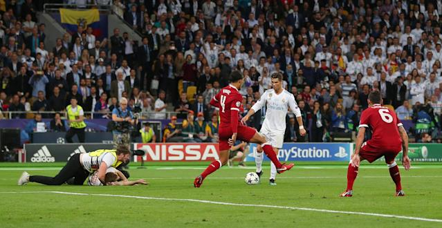 Soccer Football - Champions League Final - Real Madrid v Liverpool - NSC Olympic Stadium, Kiev, Ukraine - May 26, 2018 Real Madrid's Cristiano Ronaldo in action with Liverpool's Virgil van Dijk as a pitch invader is tackled by stewards REUTERS/Hannah McKay