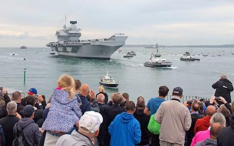 Crowds watch as HMS Queen Elizabeth comes into Portsmouth - Credit: Victoria Jones/PA