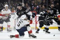 Los Angeles Kings left wing Austin Wagner, top, collides with Florida Panthers defenseman Aaron Ekblad during the second period of an NHL hockey game Thursday, Feb. 20, 2020, in Los Angeles. (AP Photo/Mark J. Terrill)
