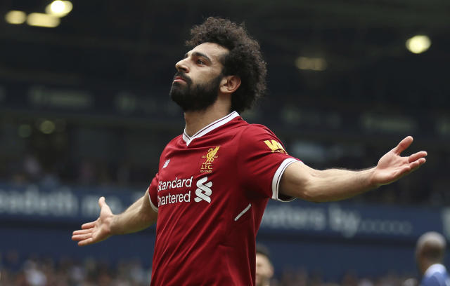 Liverpool's Mohamed Salah celebrates tying the Premier League record for goals in a 38-game season in Liverpool's 2-2 draw at West Brom. (AP)